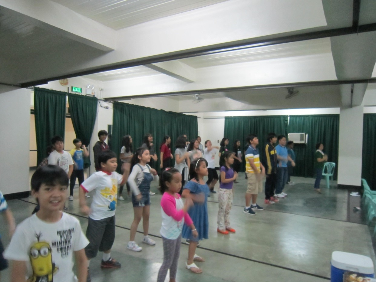 The teachers moved to the groove as they led the new students to an energetic dance.